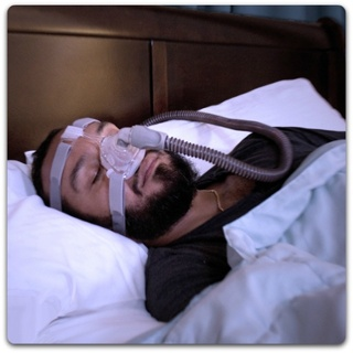 Patient Sleeping with CPAP Mask Image