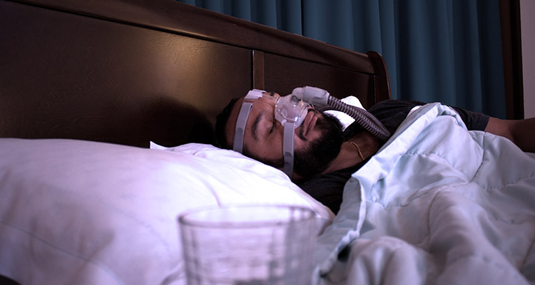 Man with CPAP Mask Sleeping Image