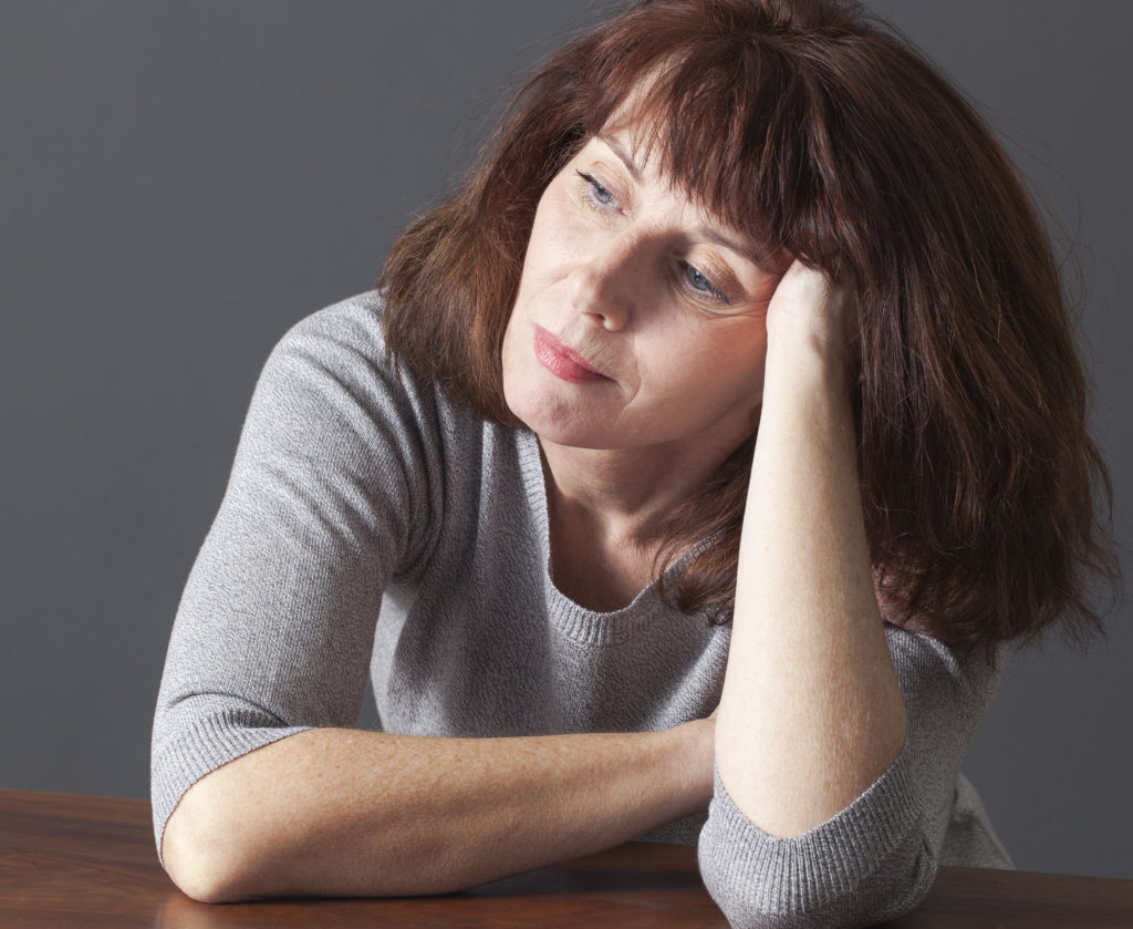 Senior Woman Resting Her Face on Her Hands Image