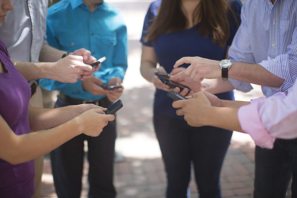 People on Cell Phones Image