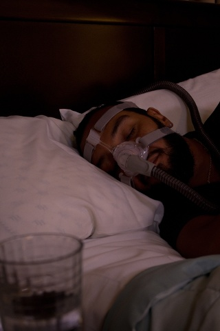 Man Sleeping with a CPAP Mask Image