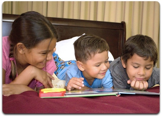 Group of Children Reading a Book Image