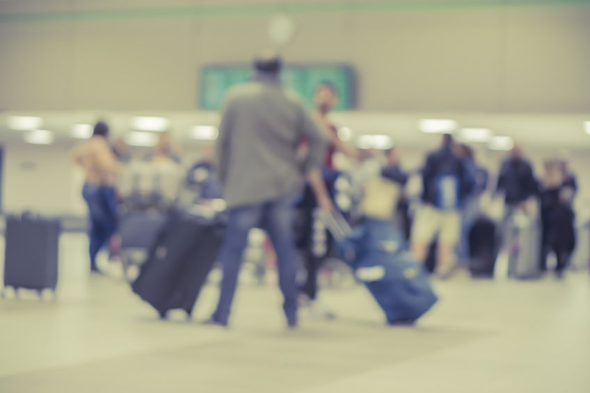 Blurred Background of People Walking in the Airport Image