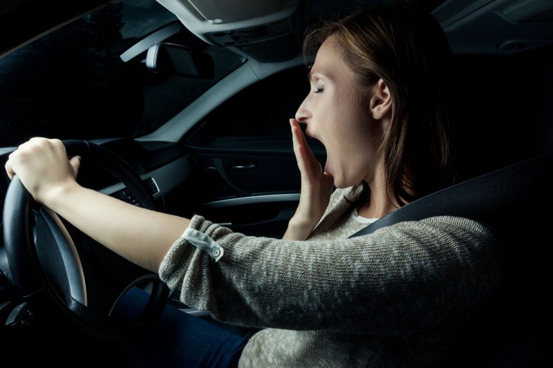 Lady Yawning Driving Vehicle Image